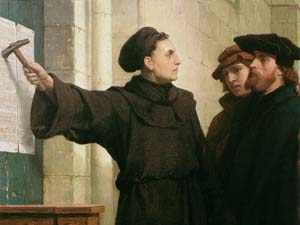 "Artist Ferdinand Pauwels' 1872 piece, ""Luther Posting the 95 Theses,"" depicting Martin Luther's act in 1517. Image courtesy of Wikimedia Commons"